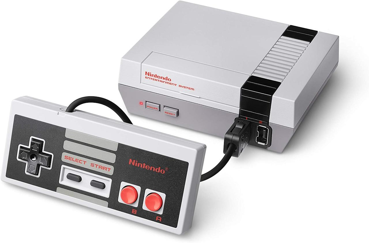"""<p>Get this <a href=""""https://www.popsugar.com/buy/Nintendo-Entertainment-System-500556?p_name=Nintendo%20Entertainment%20System&retailer=amazon.com&pid=500556&price=99&evar1=news%3Aus&evar9=42737846&evar98=https%3A%2F%2Fwww.popsugar.com%2Fnews%2Fphoto-gallery%2F42737846%2Fimage%2F46750019%2FNintendo-Entertainment-System&list1=gifts%2Choliday%2Cgift%20guide%2Ctech%20gifts%2Cgifts%20for%20men%2Cgifts%20under%20%24100&prop13=api&pdata=1"""" rel=""""nofollow"""" data-shoppable-link=""""1"""" target=""""_blank"""" class=""""ga-track"""" data-ga-category=""""Related"""" data-ga-label=""""https://www.amazon.com/Nintendo-Entertainment-System-NES-Classic/dp/B01IFJBQ1E/ref=sr_1_12?keywords=tech+gifts+for+men&amp;qid=1570742660&amp;sr=8-12"""" data-ga-action=""""In-Line Links"""">Nintendo Entertainment System</a> ($99) for the guy who loved the classic game.</p>"""