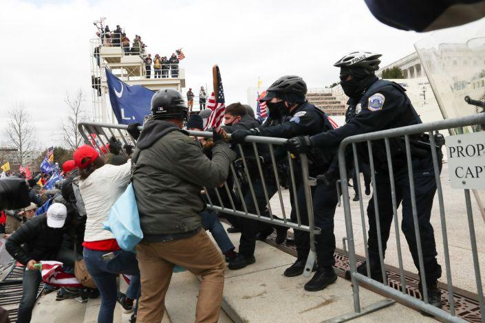 Supporters of U.S. President Donald Trump clash with police officers outside of the U.S. Capitol Building in Washington, U.S., January 6, 2021. REUTERS/Leah Millis