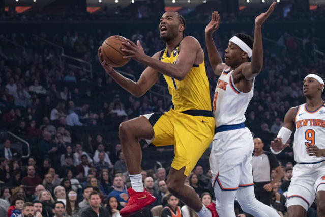 Indiana Pacers forward T.J. Warren (1) goes to the basket past New York Knicks guard Frank Ntilikina (11) in the first half of an NBA basketball game, Friday, Feb. 21, 2020, at Madison Square Garden in New York. (AP Photo/Mary Altaffer)