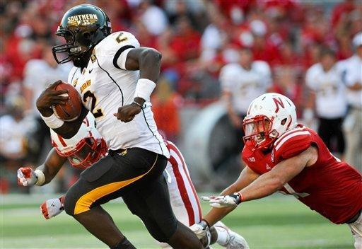 Southern Miss's Anthony Alford (2) gets by Nebraska's Will Compton (51) during an NCAA college football game, Saturday, Sept 1, 2012, in Lincoln, Neb. (AP Photo/Dave Weaver)