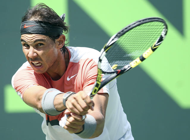 Rafael Nadal, of Spain, returns a shot from Novak Djokovic, of Serbia, during the men's final match at the Sony Open Tennis tournament on Sunday, March 30, 2014, in Key Biscayne, Fla. (AP Photo/J Pat Carter)
