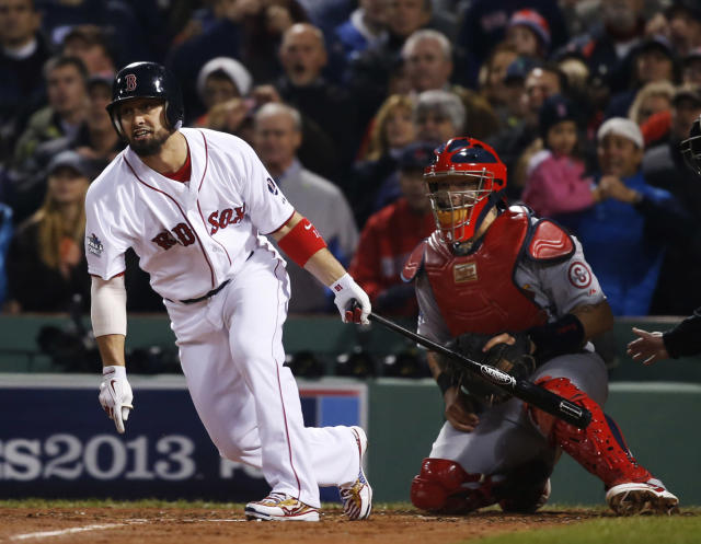 Boston Red Sox right fielder Shane Victorino and St. Louis Cardinals catcher Yadier Molina (4) watch Victorino's RBI single during the fourth inning of Game 6 of baseball's World Series Wednesday, Oct. 30, 2013, in Boston. (AP Photo/Elise Amendola)