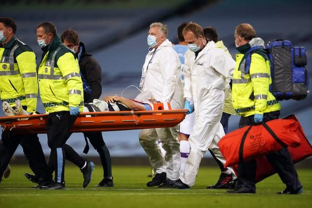 Manchester City's Eric Garcia is carried off on a stretcher (Dave Thompson/NMC Pool)