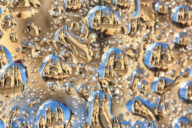 "<p>Notre Dame: Highlighting Bertrand's impressive technique. With a filter with water spray, he creates ""Tears of Paris,"" a distortion of popular iconic Parisian monuments. (Photo: Bertrand Kulik / Caters News) </p>"
