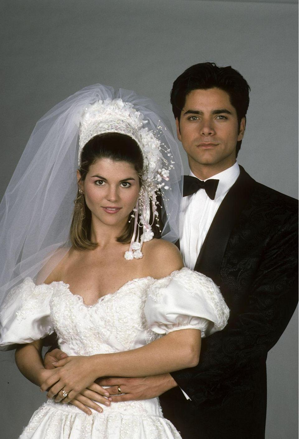 <p>I think I speak for everyone when I say <em>have mercyyy</em>. When Aunt Becky (Lori Loughlin) tied the knot to Uncle Jesse (John Stamos) in season 4, she served up some major wedding inspiration. Please note the headpiece. </p>