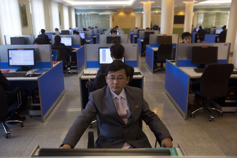 FILE - In this Jan. 8, 2013 file photo, a North Korean student works at a computer terminal inside a computer lab at Kim Il Sung University in Pyongyang, North Korea, during a tour by Executive Chairman of Google, Eric Schmidt. North Korea is literally off the charts regarding Internet freedoms. There essentially aren't any. But the country is increasingly online. Though it deliberately and meticulously keeps its people isolated and in the dark about the outside world, it knows it must enter the information age to survive in the global economy. (AP Photo/David Guttenfelder, File)