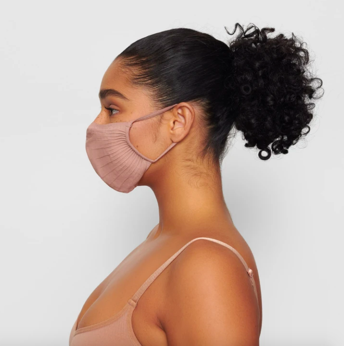 Adult Seamless Knit Face Mask in Sienna. Image via skims.com
