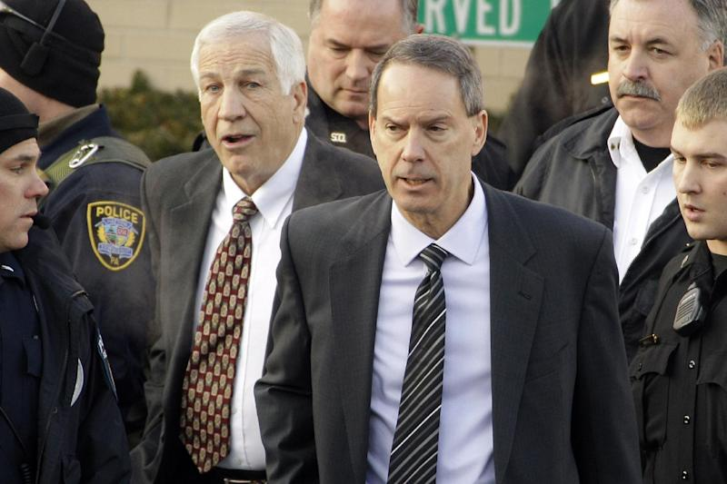 FILE - In this Dec. 13, 2011, file photo, former Penn State University assistant football coach Jerry Sandusky, center left, walks with his attorney Joe Amendola, center right, as he leaves the Centre County Courthouse in Bellefonte, Pa. Sandusky is expected to appear on Thursday, Jan., 10, 2013, inside a central Pennsylvania courtroom for a hearing about whether his lawyers had enough time to prepare for trial. (AP Photo/Gene J. Puskar, File)