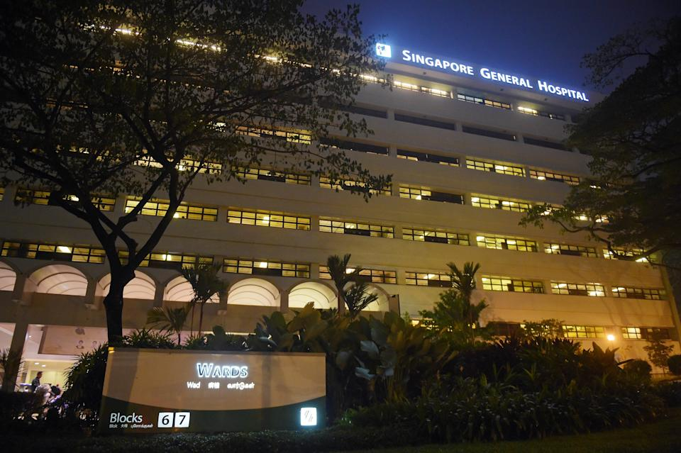 The windows of wards are seen with the sign of  Singapore General Hospital on Tuesday, Oct. 6, 2015 in Singapore.  The top public hospital in Singapore said Tuesday that four of its patients died after a new renal ward was hit by an outbreak of hepatitis C, likely from intravenous treatment. (AP Photo/Joseph Nair)
