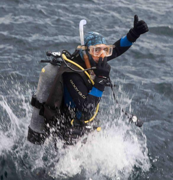 PHOTO: A Dive Warrior participant gives a thumbs up while jumping in the water off the California coast. (Gene Shabinaw)