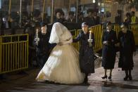 """<div class=""""caption-credit""""> Photo by: Getty Images</div>The 19-year-old bride, Hannah Batya Penet, wore a traditional white wedding dress made of lace and encrusted with pearls and crystals. Female relatives led her into the ceremony."""