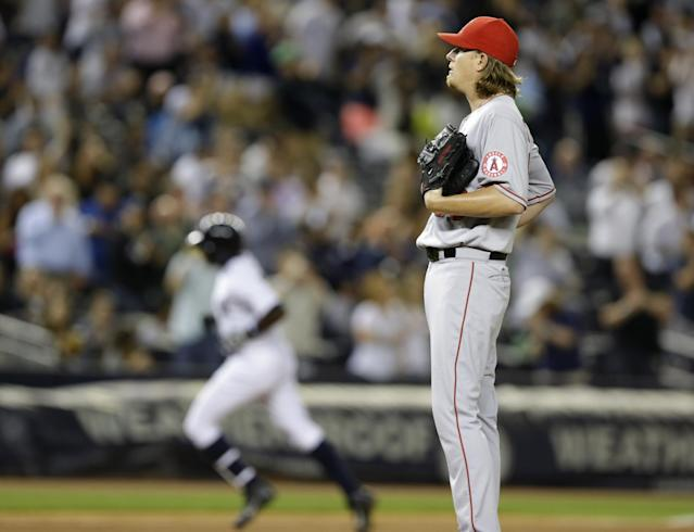 New York Yankees' Alfonso Soriano, left, rounds the bases on a fifth-inning solo home run off Los Angeles Angels starting pitcher Jered Weaver in a baseball game, Wednesday, Aug. 14, 2013, in New York. (AP Photo/Kathy Willens)