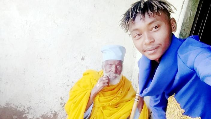 Aba Tilahun's grandson, seen here with his grandfather several years ago, is now looking after him at home