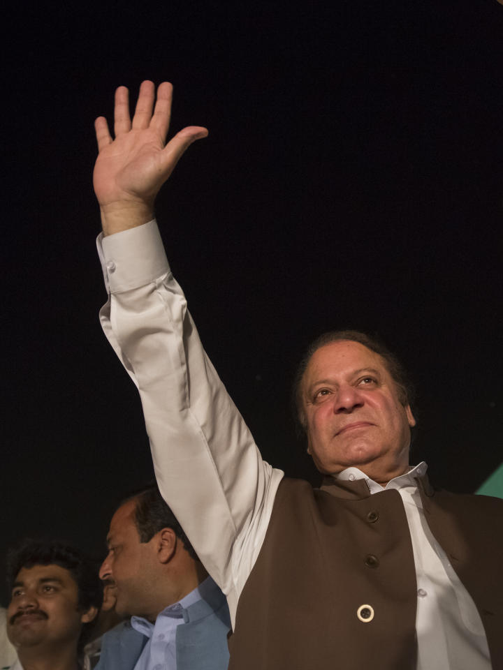 MULTAN, PAKISTAN - MAY 03: Nawaz Sharif, leader of political party Pakistan Muslim League-N (PMLN), waves prior to addressing supporters during an election campaign rally on May 03, 2013 in Multan, Pakistan. Pakistan's parliamentary elections are due to be held on May 11. Imran Khan of Pakistan Tehrik e Insaf (PTI) and Nawaz Sharif of the Pakistan Muslim League-N (PMLN) have been campaigning hard in the last weeks before polling. (Photo by Daniel Berehulak/Getty Images)