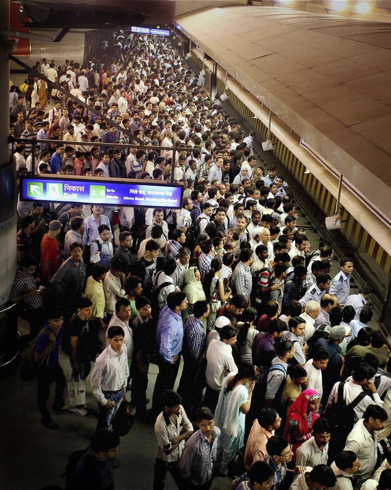 Commuters wait for a metro train, in New Delhi, India, Monday, July 30, 2012. Northern India's power grid crashed Monday, halting hundreds of trains, forcing hospitals and airports to use backup generators and leaving 370 million people - more than the population of the United States and Canada combined - sweltering in the summer heat. (AP Photo)