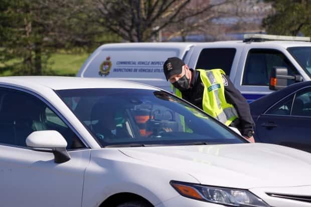 Ottawa police at COVID-19 checkpoints on the Ontario and Quebec border on April 19, 2021. Less than two days after the patrols began, police announced they would no longer be monitoring the bridges and ferries 24/7. (Francis Ferland/CBC - image credit)
