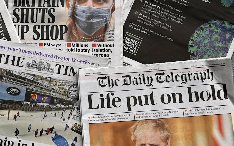 UK daily newspapers on March 17 as the UK tightened restrictions during the first wave  - PAUL ELLIS/AFP