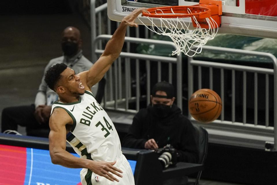 Milwaukee Bucks' Giannis Antetokounmpo dunks during the first half of an NBA basketball game against the Oklahoma City Thunder Friday, Feb. 19, 2021, in Milwaukee. (AP Photo/Morry Gash)
