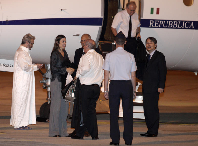 Australian lawyer Melinda Taylor, second from left, and President of the International Criminal Court (ICC) Sang-Hyun Song, of South Korea, prepare to board a plane to Rotterdam after disembarking from Tripoli at Rome's Ciampino military airport after being released from Libya, Monday, July 2, 2012. Taylor is one of the four International Criminal Court staffers who had been held for nearly four weeks on allegations that they shared documents that could harm national security with Moammar Gadhafi's imprisoned son Seif al-Islam Gadhafi. (AP Photo/Riccardo De Luca)