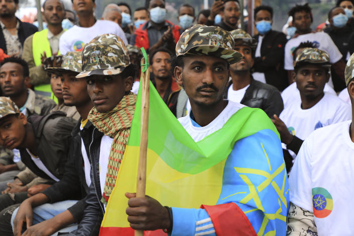 Youth joining the Defense Forces are escorted to Meskel Square, in Addis Ababa, Ethiopia, Tuesday, July 27 2021. A repatriation program is underway for young people from Ethiopia who have decided to join the Defense Forces. (AP Photo)