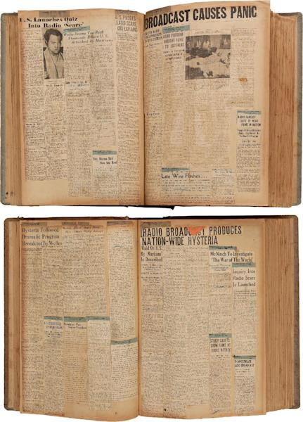 """This photo provided by Heritage Auctions shows two scrapbooks filled with newspaper clippings about the nationwide panic from Orson Welles' 1938 radio broadcast of """"War of the Worlds"""" which are among the Welle's items consigned by his daughter, Beatrice, that will be offered by Heritage Auctions in New York City on April 26, 2014. (AP Photo/Heritage Auctions) Photo credit:"""