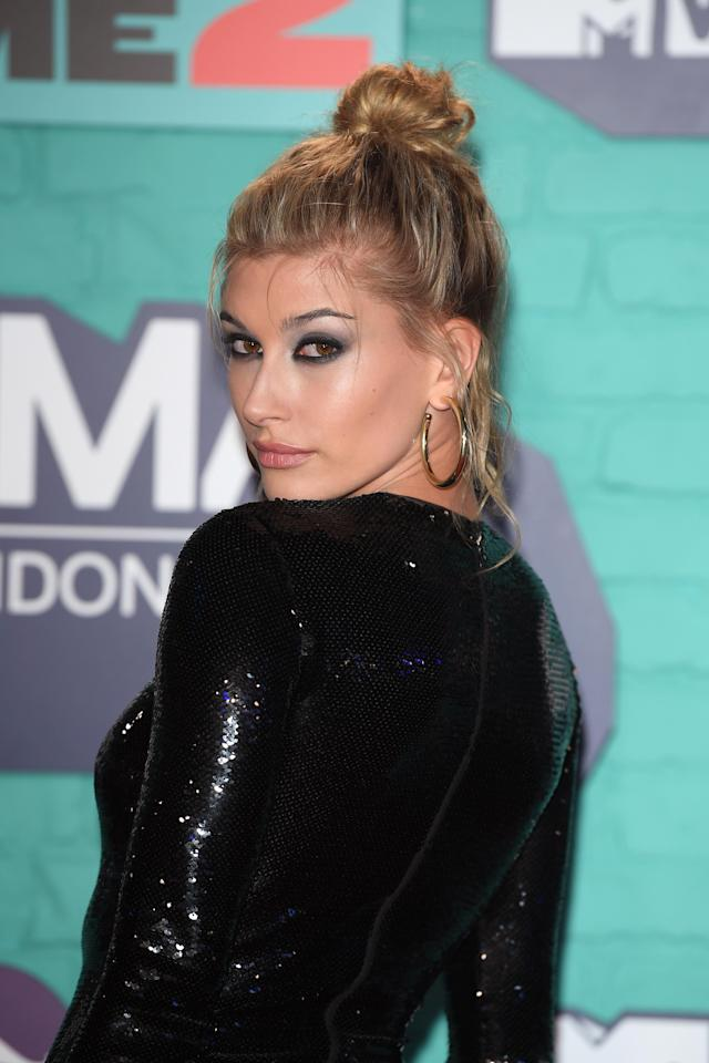 <p>Hailey Baldwin added some edge to her look with a smokey eye and messy top knot.</p>
