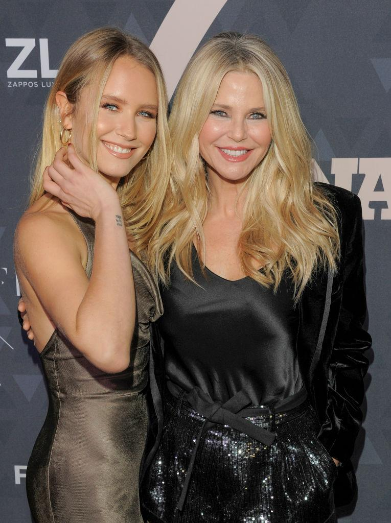 This lookalike mother-daughter duo have both graced the pages of Sports Illustrated's infamous swimsuit edition. <em>(Image via Getty Images)</em>