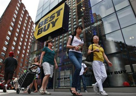 People walk past a Best Buy store in New York