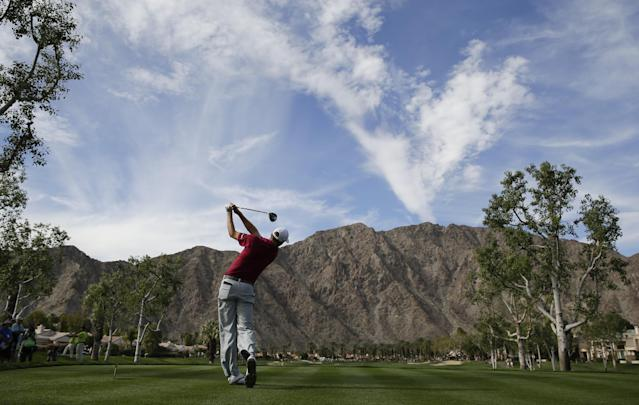Patrick Reed hits his tee shot on fourth hole during the final round of the Humana Challenge golf tournament on the Palmer Private course at PGA West, Sunday, Jan. 19, 2014, in La Quinta, Calif. (AP Photo/Chris Carlson)