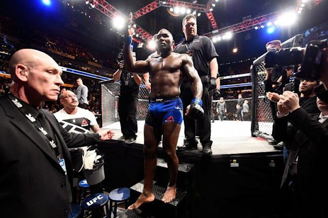 Anthony Johnson acknowledges the crowd as he leaves the Octagon for the final time. Johnson announced his retirement after losing to Daniel Cormier on Saturday in Buffalo, N.Y. (Getty Images)