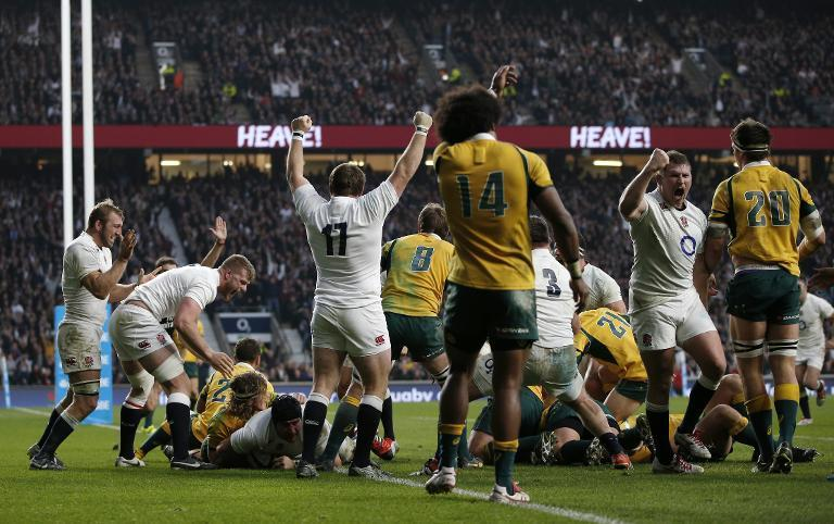England players celebrate after Ben Morgan (3rd L) scores his second try from a rolling maul during the Autumn International match against Australia at Twickenham Stadium, southwest of London on November 29, 2014 (AFP Photo/Adrian Dennis)