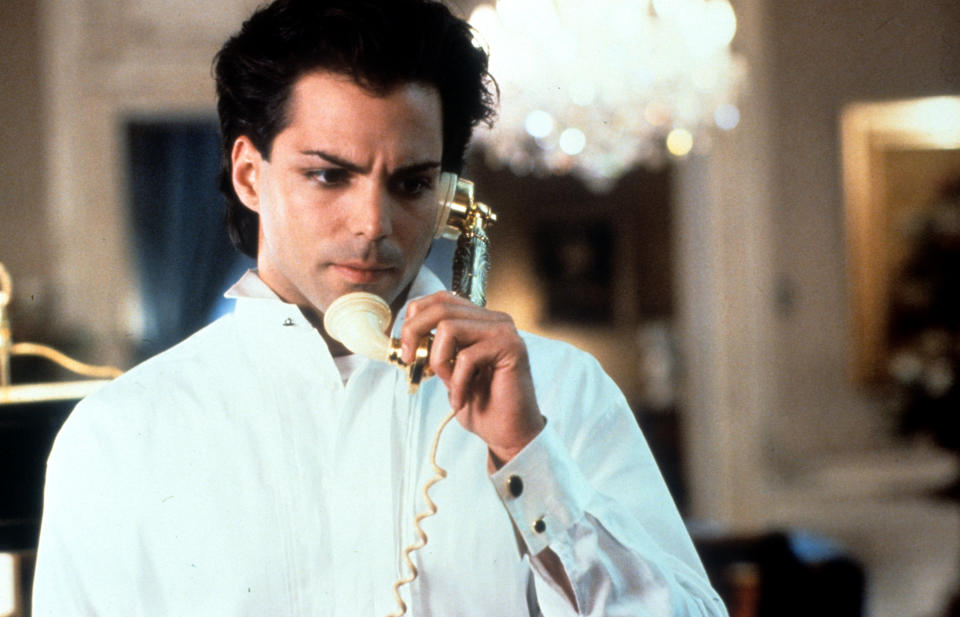 Richard Grieco wearing black eyeliner, with a phone receiver to his ear in a scene from the film 'If Looks Could Kill', 1991. (Photo by Warner Brothers/Getty Images)