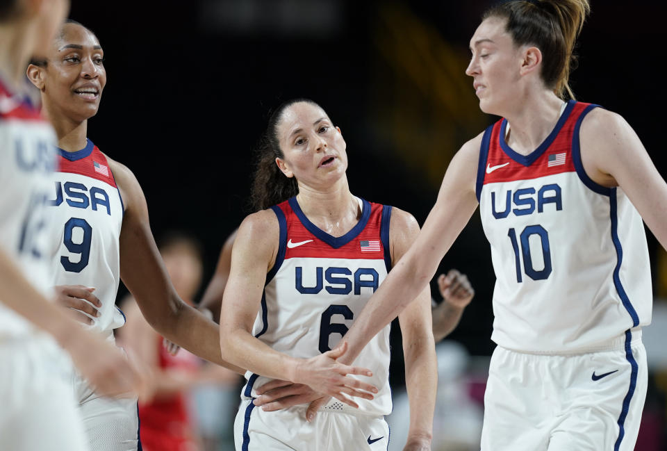 United States' Sue Bird (6), center, celebrates with teammates after making a shot during women's basketball preliminary round game against Japan at the 2020 Summer Olympics, Friday, July 30, 2021, in Saitama, Japan. (AP Photo/Charlie Neibergall)