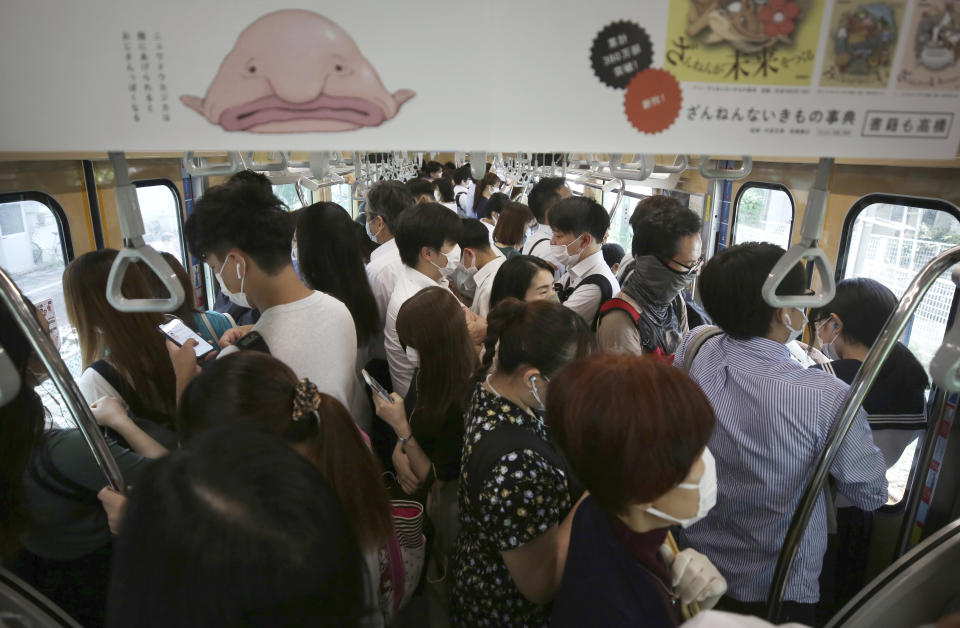 An inside of train is packed with passengers on a JR Line during a rush hour in Ota Ward, Tokyo on June 15, 2020, after Tokyo Alert was lifted in last month. Source: Getty