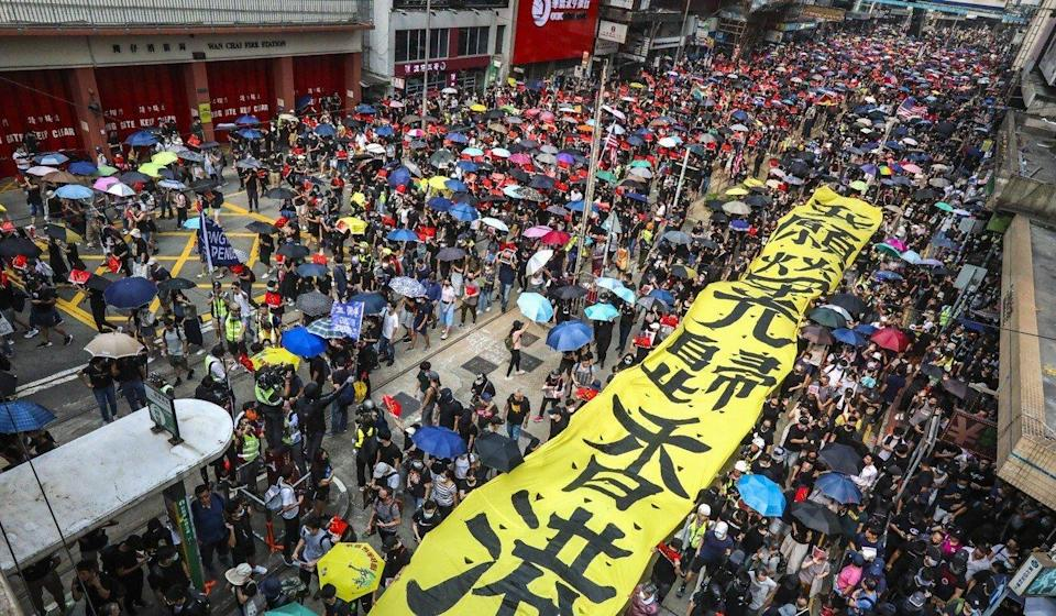 Protesters, with a banner reading 'Glory to Hong Kong' gather on Hennessy Road, Wan Chai, in September 2019. Photo: Felix Wong