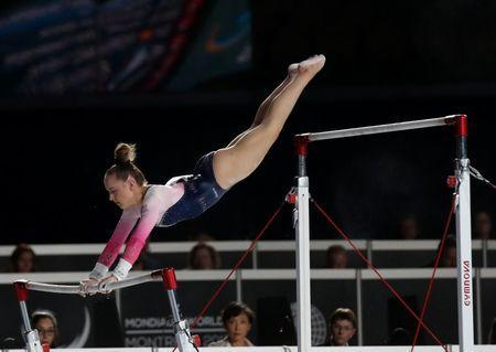 Oct 3, 2017; Montreal, Quebec, CAN; Amy Tinkler of Great Britain competes on the uneven bars during the 47th FIG Artistic Gymnastics World Championship at Montreal Olympic Stadium. Mandatory Credit: Jean-Yves Ahern-USA TODAY Sports