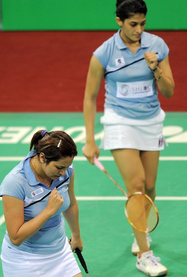 Indian Badminton players Jwala Gutta (L) and Ashwini Ponnappa (R) celebrate a point against Marissa Vita and Melati Nadya of Indonesia during the Yonex-Sunrise India Open 2012 at the Siri Fort Sports Complex in New Delhi on April 26, 2012. The Indian pair won 16-21, 21-15, 21-17.     AFP PHOTO/ MANAN VATSYAYANA        (Photo credit should read MANAN VATSYAYANA/AFP/GettyImages)