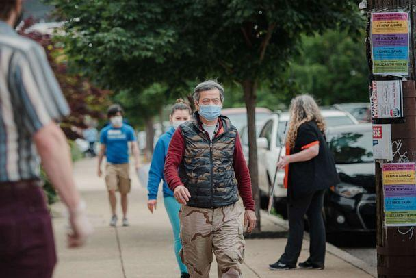 PHOTO: Voters walk to a polling station in Philadelphia, June 2, 2020. (Hannah Yoon/Bloomberg via Getty Images)