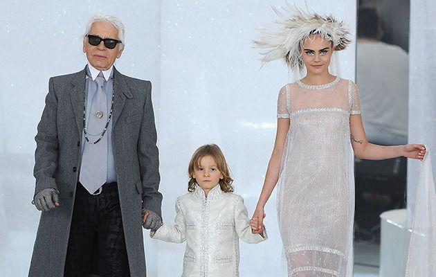 Karl Lagerfeld walks the Chanel catwalk with his godson Hudson and Cara Delevingne. Image: Getty Images