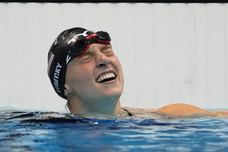 Kathleen Ledecky, of United States, celebrates after winning the gold medal in the women's 800-meter freestyle final at the 2020 Summer Olympics, Saturday, July 31, 2021, in Tokyo, Japan. (AP Photo/Gregory Bull)