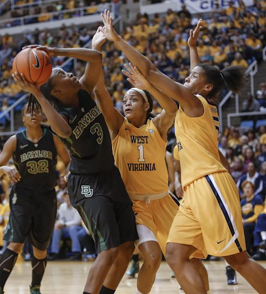 Baylor's Jordan Madden (3) looks for a shot as West Virginia's Christal Caldwell (1) and Averee Fields (5) defend during the first half of an NCAA college basketball game at WVU Coliseum in Morgantown, W.Va., on Saturday, March 2, 2013. (AP Photo/David Smith)