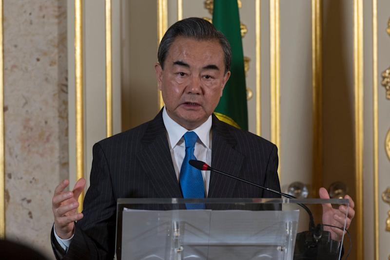 """LISBON, PORTUGAL - MAY 18: State Councilor and Minister of Foreign Affairs of the People's Republic of China, Wang Yi delivers remarks during the joint press conference with Portuguese Foreign Minister Augusto Santos Silva at the end of their meeting at Necessidades Palace to assess the Global Strategic Partnership between Portugal and China and to discuss the adherence of Portugal to the """"Track and Route"""" Initiative, launched in 2013 by President Xi Jinping, on May 18, 2018 in Lisbon, Portugal. (Photo by Horacio Villalobos - Corbis/Corbis via Getty Images)"""