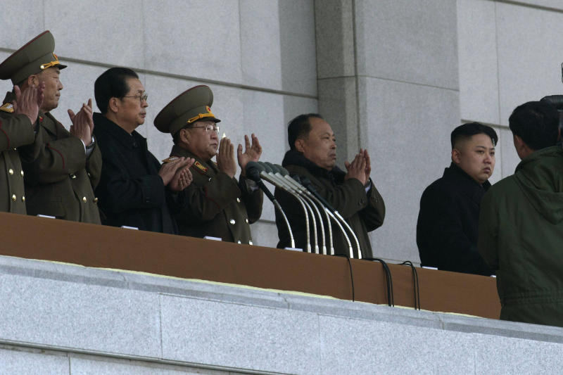 FILE - In this Dec. 17, 2012 file photo, North Korean leader Kim Jong Un, right, and his uncle Jang Song Thaek, second from left, attend a ceremony to reopen the Kumsusan Palace of the Sun in Pyongyang. North Korea's propaganda machine has long kept alive the myth of a serene, all-powerful ruling dynasty that enjoyed universal love and support at home. In a single stroke last week, that came crashing down. In attempting to justify the execution of his uncle, who was also considered the North's No. 2 official, young leader Kim Jong Un has given the world a rare look behind the scenes of a notoriously hard-to-read government. (AP Photo/Ng Han Guan, File)