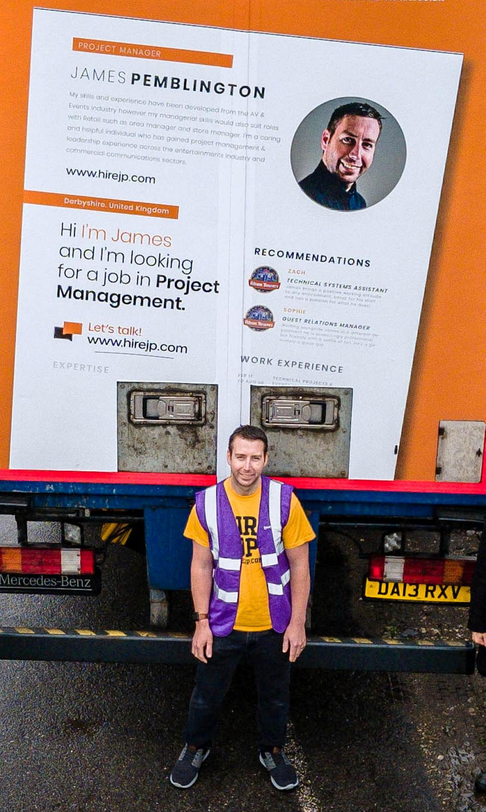 James Pemblington in front of the lorry with his CV on the back. (SWNS)