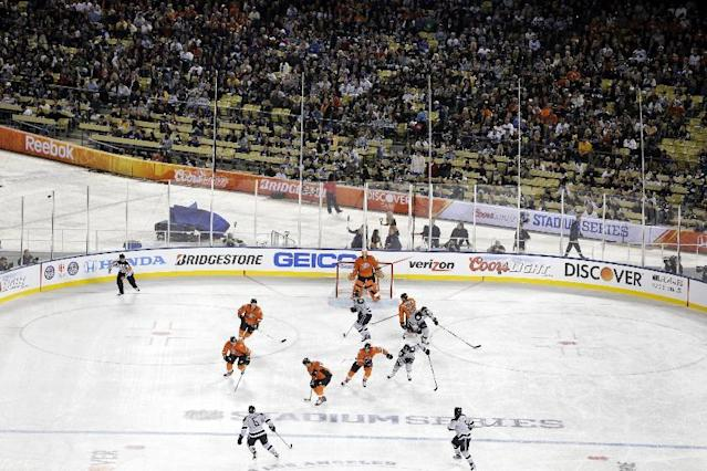 The Los Angeles Kings and the Anaheim Ducks skate during the first period of an NHL outdoor hockey game at Dodger Stadium on Saturday, Jan. 25, 2014, in Los Angeles. (AP Photo/Jae C. Hong)