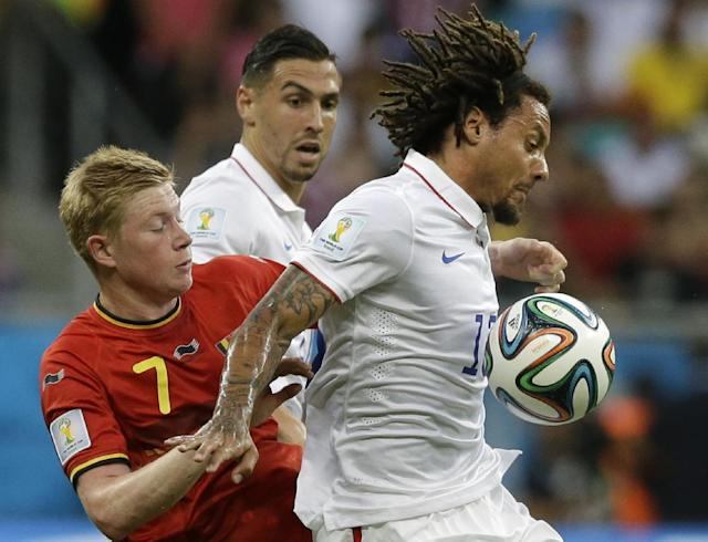 United States' Jermaine Jones, right, holds off Belgium's Kevin De Bruyne during the World Cup round of 16 soccer match between Belgium and the USA at the Arena Fonte Nova in Salvador, Brazil, Tuesday, July 1, 2014. (AP Photo/Matt Dunham)