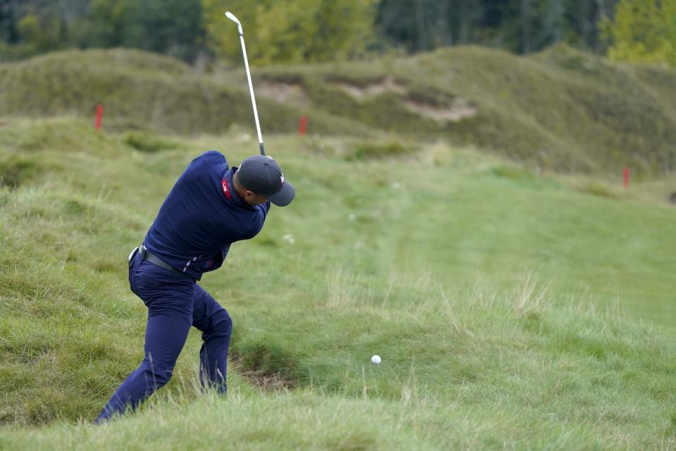 Team USA's Justin Thomas hits on the fifth hole during a practice day at the Ryder Cup at the Whistling Straits Golf Course Tuesday, Sept. 21, 2021, in Sheboygan, Wis. (AP Photo/Charlie Neibergall)