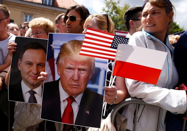 <p>People holding portraits of President Donald Trump and Polish President Andrzej Duda wait for President Donald Trump's public speech at Krasinski Square, in Warsaw, Poland July 6, 2017. (Photo: Kacper Pempel/Reuters) </p>
