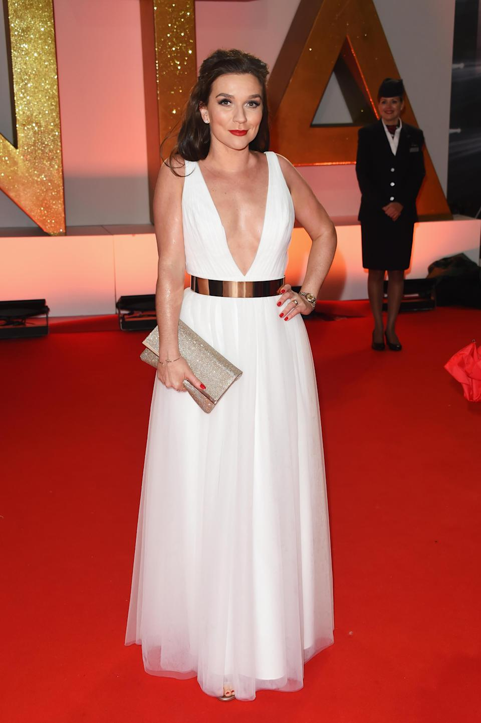 <p>Wearing a floaty white gown and her signature red lip. <em>[Photo: Getty]</em> </p>