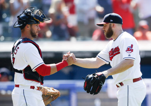Cleveland's Yan Gomes, left, and Cody Allen celebrate a victory over the New York Yankees in July. (AP)